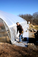 Larry adding roll-up to greenhouse side