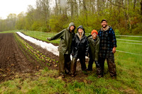 A very wet Provider Farm crew in front of their work