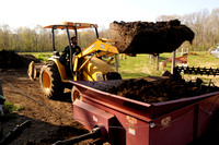 Loading compost into the spreader
